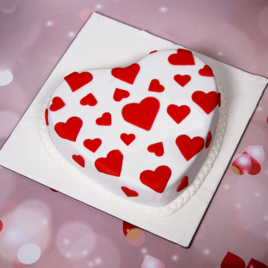 Heart shape Fondant cake with red hearts