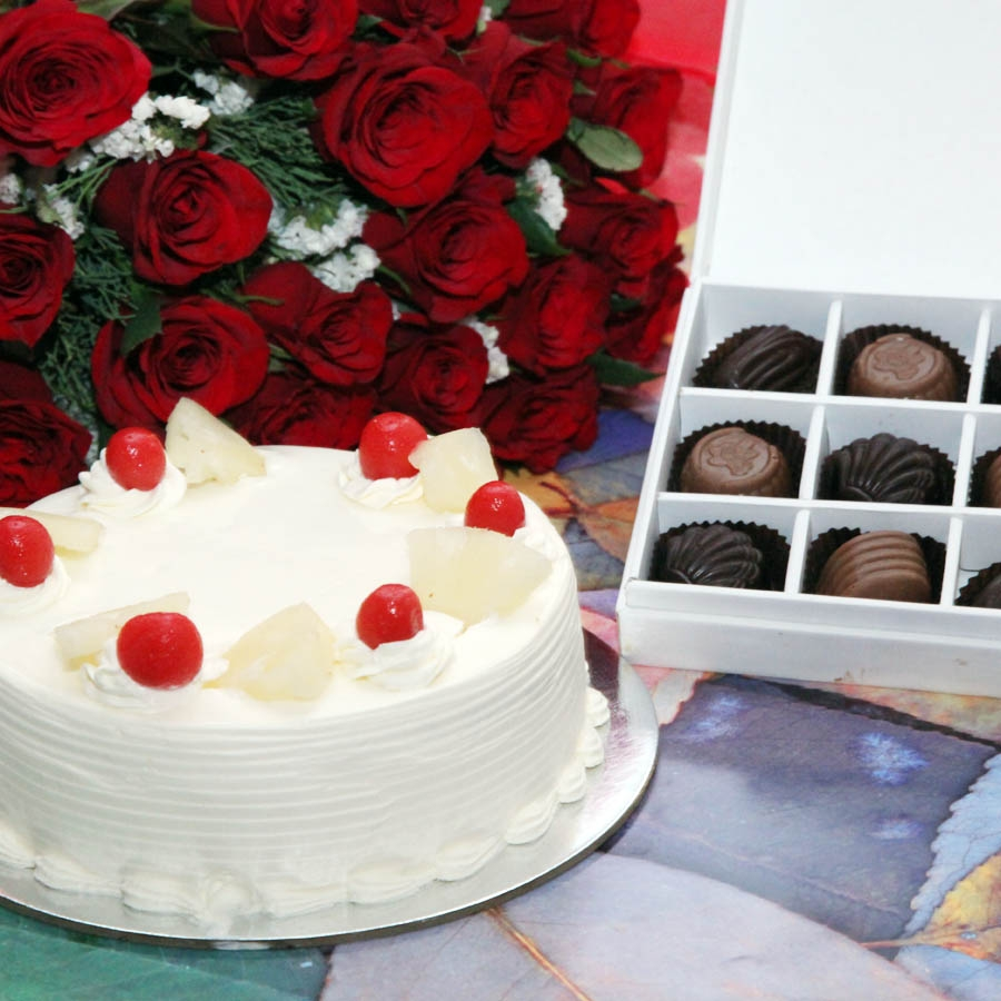 Pineapple Cake  - 500gms ,Red hand bouquet and Box of 9 chocolate pralines