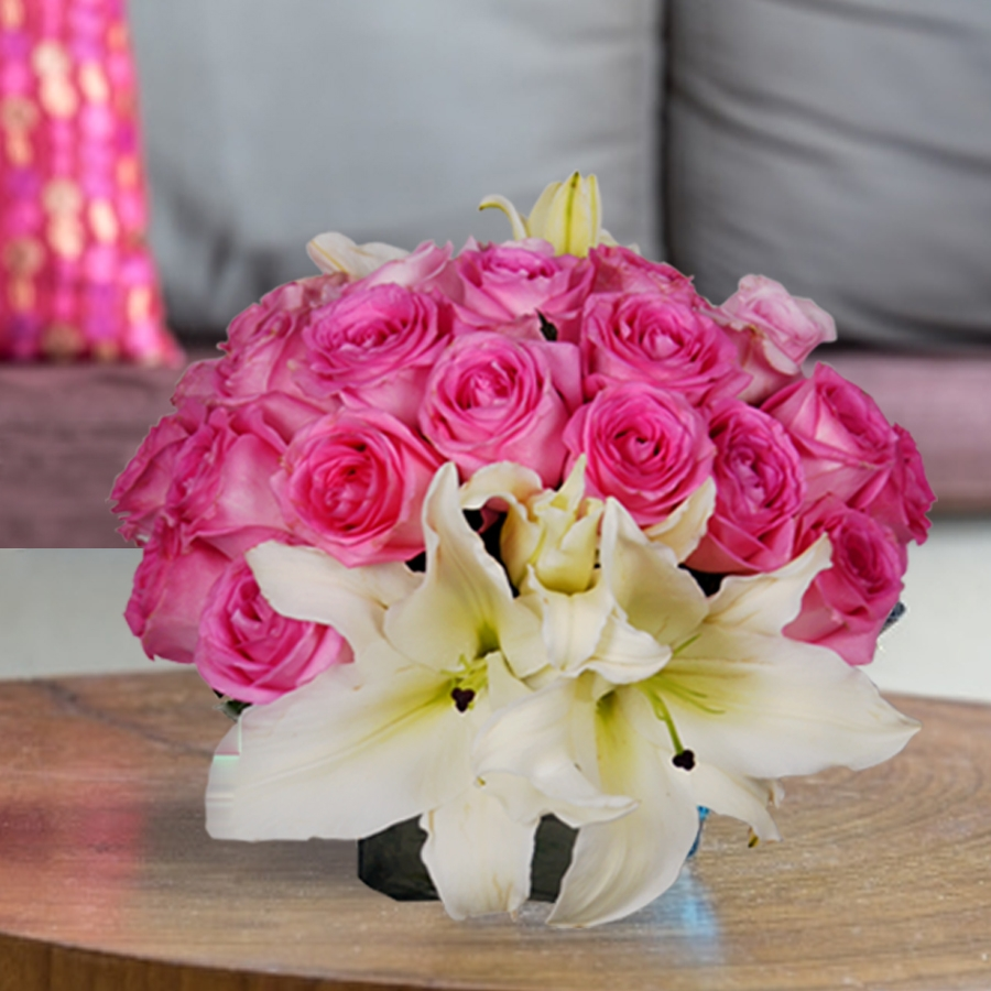 Vase of pink roses & white lillies