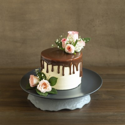 Pure butter almond cake French vanilla butter cream  with Pink Jumelias 900gms