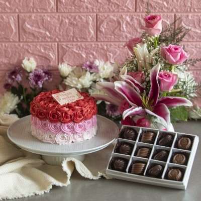 Mothers day Shaded pink Rosette cake 750g Box Of 9 Pralines and arrangement of Lillies and Roses in a mug
