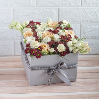 Beautiful Grey Box Of Tube roses, Spray Carnations, White Roses And Peach Roses