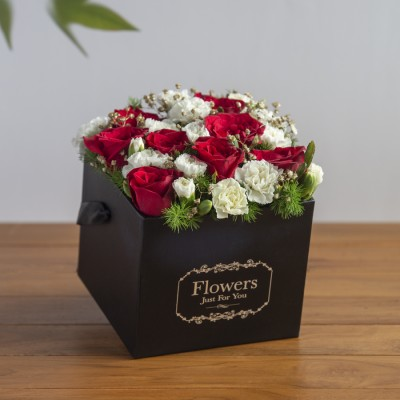 Red roses spray carnations baby breath in a black box