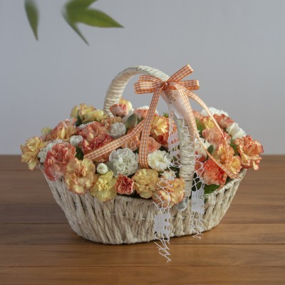 Yellow & white spray Carnations in a basket