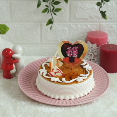 Butterscotch Cake with love hearts topper