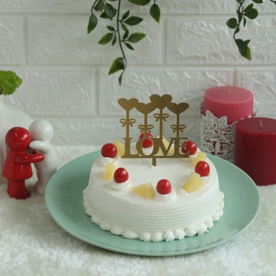 Pineapple Cake with love hearts topper