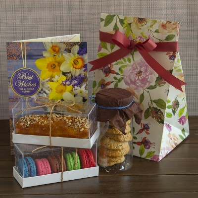 Multigrain cookies ,almond bar cake ,box of 5 Assorted Macarons  and a Best wishes Card [Contains Egg]