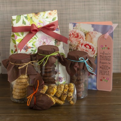 Floral bag with Assorted  cookies and a congratulations card