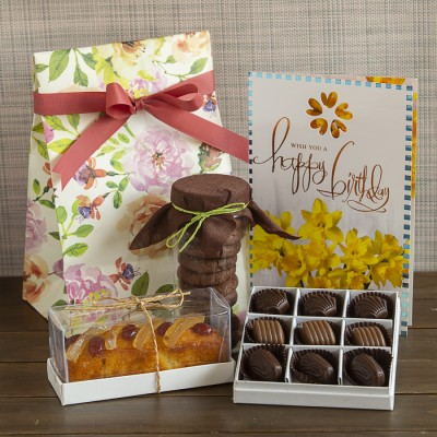 Floral bag with chocolate fudge cookies ,candied lemon orange cake ,box of 9 chocolate pralines and birthday card