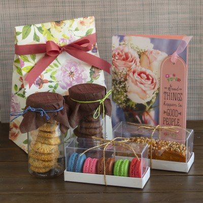 Floral bag with Cookies (swedish oatmeal and choco chip) ,box of 5 macarons ,almond bar cake and congratulations card [Contains Egg]