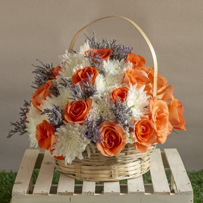 Arrangement of White Chrysanthemums and orange  Roses in a Baskets