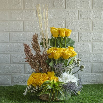 Arrangement of Yellow Roses , Dry Sticks and White Chrysanthemums  in a Basket