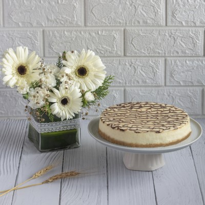 Philadelphia Cheese Cake With Vase Of White Gerbaras and White Carnations