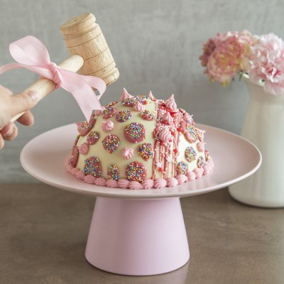 White Chocolate Piñata Cake Filled with Chocolates and Hammer