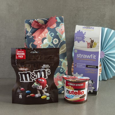 M & M's ,Strawfit , Nutella Brot Sticks in a floral bag