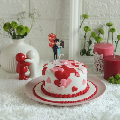 Red  and pink hearts cake with cute couple topper