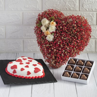 White And Red Heart Shape Dutch Truffle With Heart Shape Chocolate Pralines And Red Heart Shape Flower Arrangements