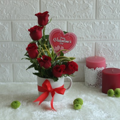 Arrangement of Red Roses in a mug with Happy valentines day topper