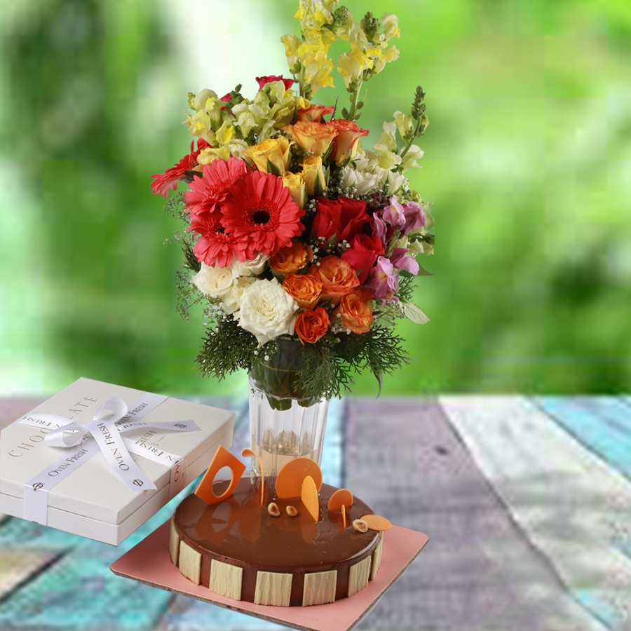 Caramel Panacotta Cake 500gms , Box of 12 pralines & vase with assorted flowers