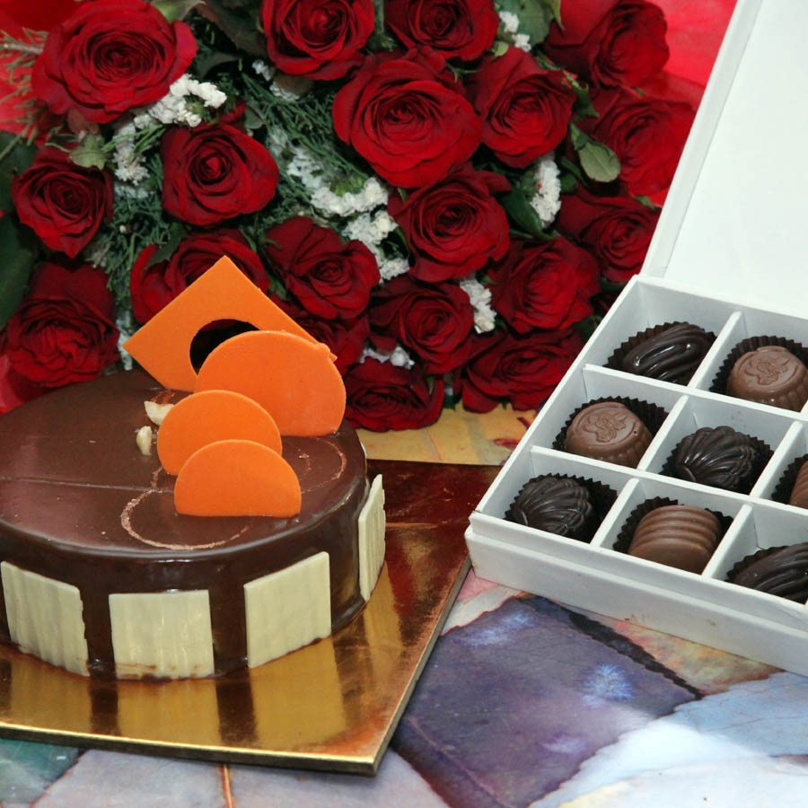 Caramel Panacotta with Hazelnut Chocolate Mousse Cake- 500gms , red hand bouquet and Box of 9 chocolate pralines