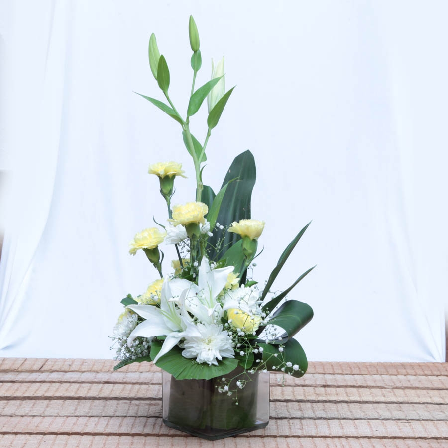 Glass vase of lillies and carnations flowers