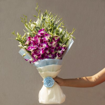 Hand Bouquet of Orchids and Leaves