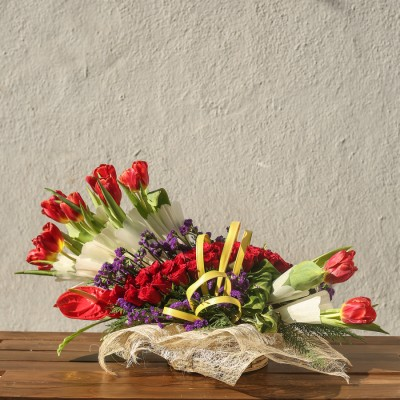 Arrangement of tulips and red roses
