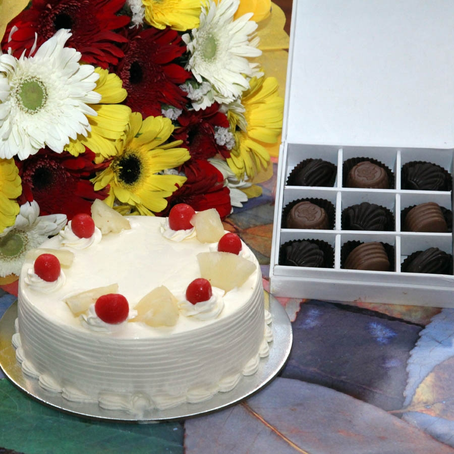 Pineapple Cake  - 500gms, hand bouquet of gerbera and Box of 9 chocolate pralines