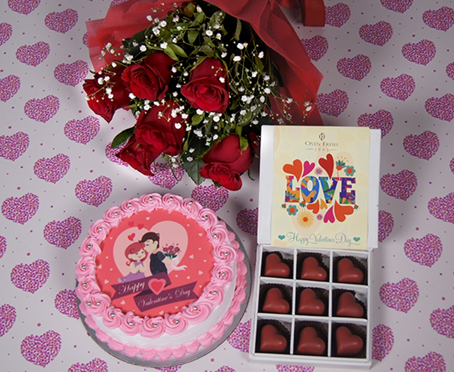 Valentines day  photo cake  desire cake 500gms with Hand Bouquet of 6 red roses  and box of 9 raspberry heart chocolate pralines